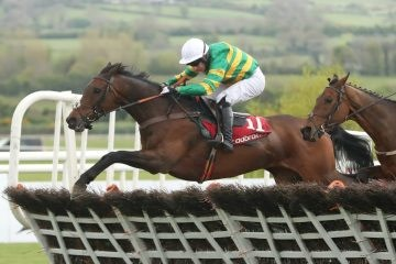 Unowhatimeanharry ridden by Noel Fehily (left) goes on to win The Ladbrokes Champion Stayers Hurdle ahead of Nichols Canyon ridden by Ruiby Walsh during day three of the Punchestown Festival in Naas, Co. Kildare.