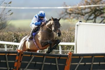 Sean Bowen riding Boothill clear the last to win The Racing To School Novices' Hurdle at Taunton Racecourse. Picture date: Thursday December 8, 2020. See PA story RACING Taunton. Photo credit should read: Alan Crowhurst/PA Wire. RESTRICTIONS: Use subject to restrictions. Editorial use only, no commercial use without prior consent from rights holder.